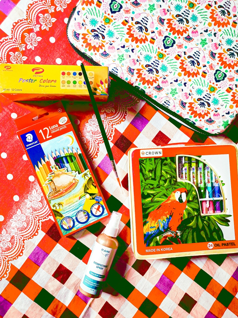 some acrylic colors, sme pencil colors, some crayons with a laptop bag from Suchi Shoili on facebook. there is also a hand sanitizer. these are bought by the aboltabol maa, or the royal bengal mom who is a bangladeshi mom blogger from dhaka bangladesh. she is a prominent writer in bangladesh