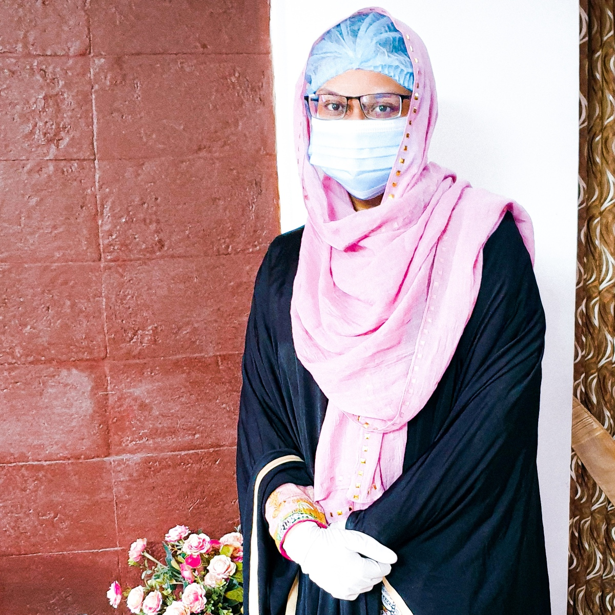 The image of Ava, The Aboltabol Maa, a Bangladeshi writer wearing safety gears because of the pandemic. She is one of the first Bangladeshi mom bloggers, a Bangladesh based parenting blogger, living in Dhaka.