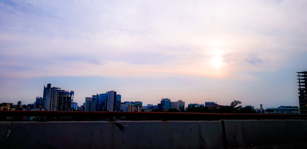 the sunset of dhaka sky. The story is about the first day of lockdown, written by Ava the aboltabol maa, one of the first bangladeshi mom bloggers, a parenting blogger of Bangladesh, she is a Bangladeshi younng writer. she is a bangladesh based blogger, living in dhaka.